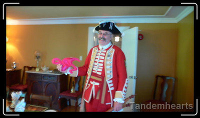 The town crier came by and was interested in talking with Clyde.