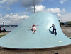 These kids found a practical use for this rather ugly sculpture in the harbor.