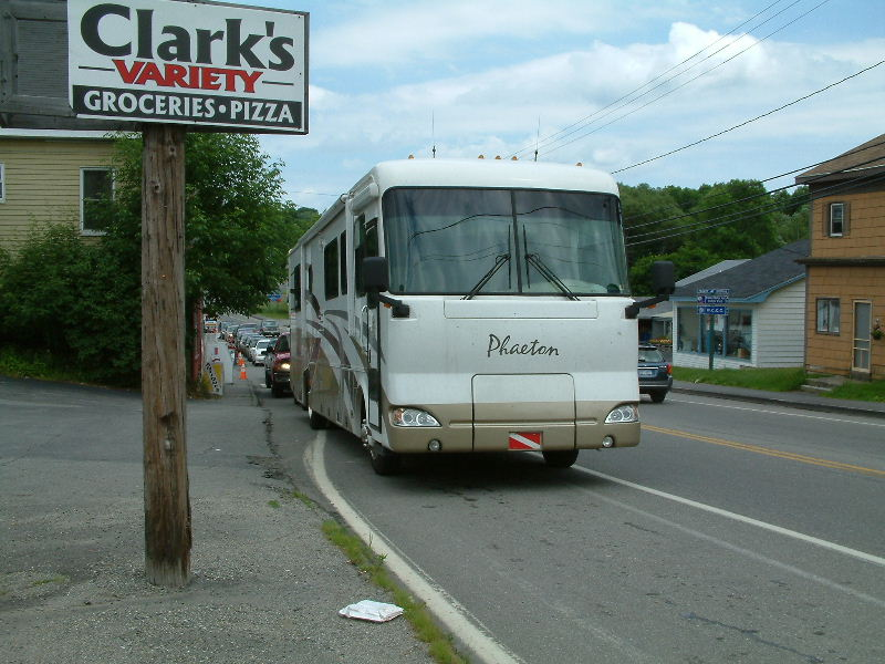 Line behind motorhome extending through town waiting to cross the border into Canada.