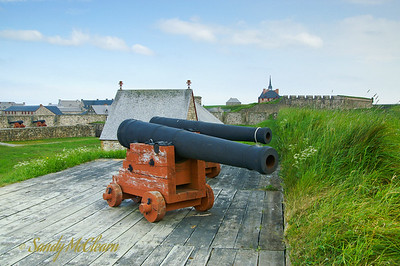 Two cannon on the wall in the fortress.