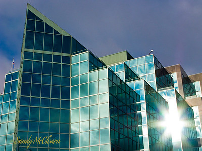 The sun reflects off the windows of Summit Place on Lower Water Street.