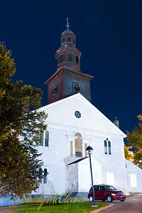 A night photo of St. Paul's Anglican Church, which sits at one end of Grand Parade.