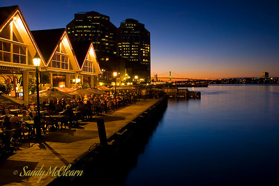 Dusk on the Halifax Waterfront near Historic Properties, with Purdy's Wharf in the background.