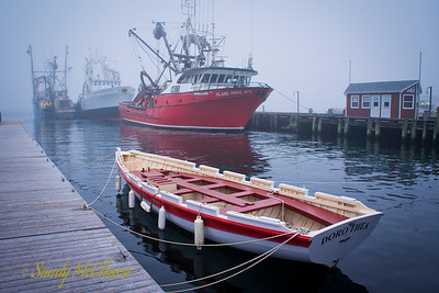 Nova Scotia Sea School's Dorothea with the herring seiner Island Pride No.1 in the background on the Halifax Waterfront in the fog.