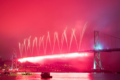 Natal Day fireworks are launched from the MacDonald Bridge in the fog.