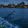 Halifax skyline at dusk, with the wake of a harbour ferry used as a lead-in line.