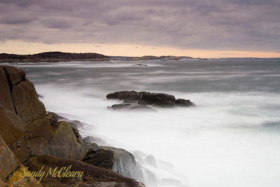 A long exposure of waves crashing on the rocks at Peggy's Cove.