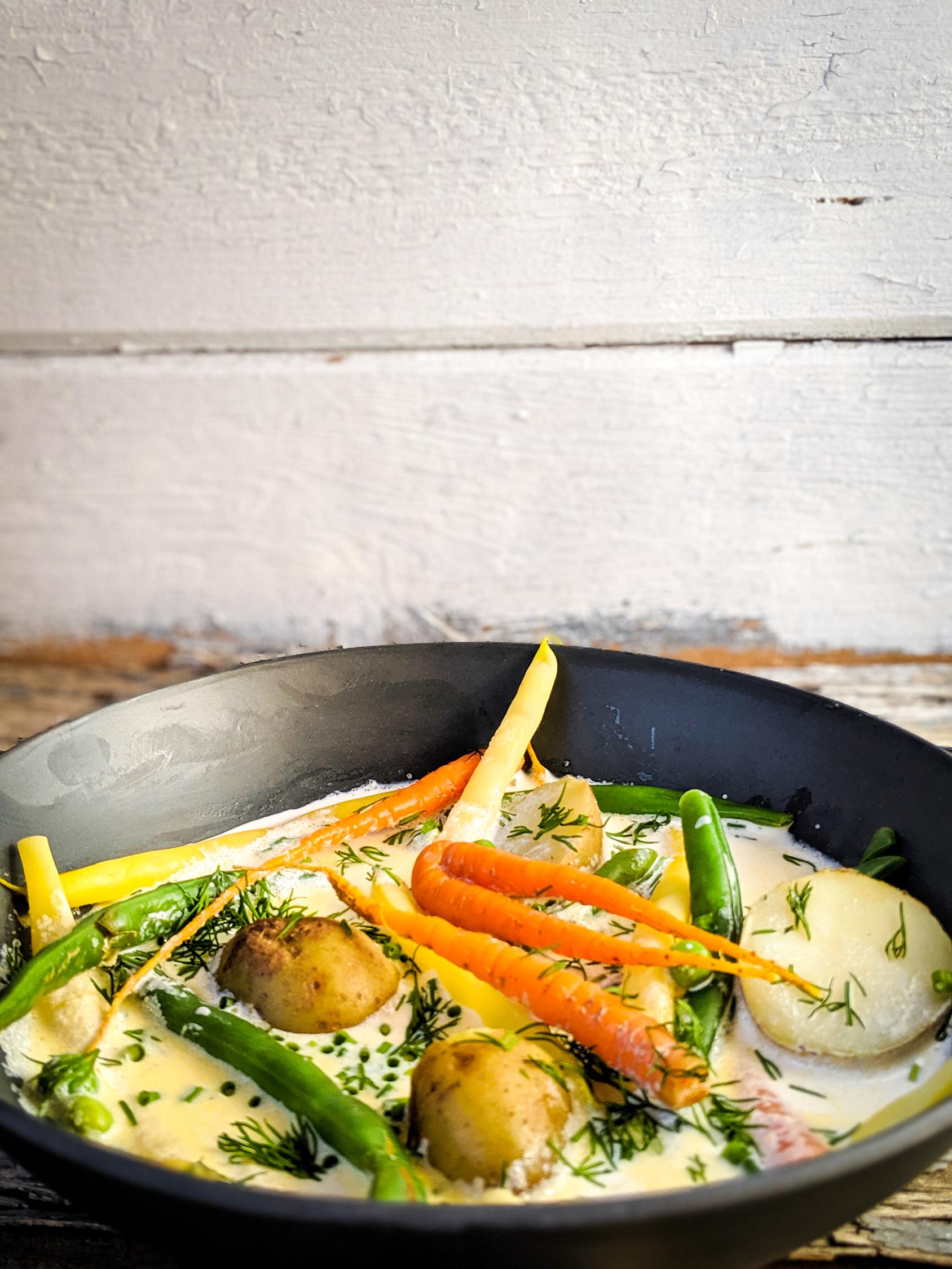 Nova Scotian hodge podge vegetable chowder in a blue bowl.