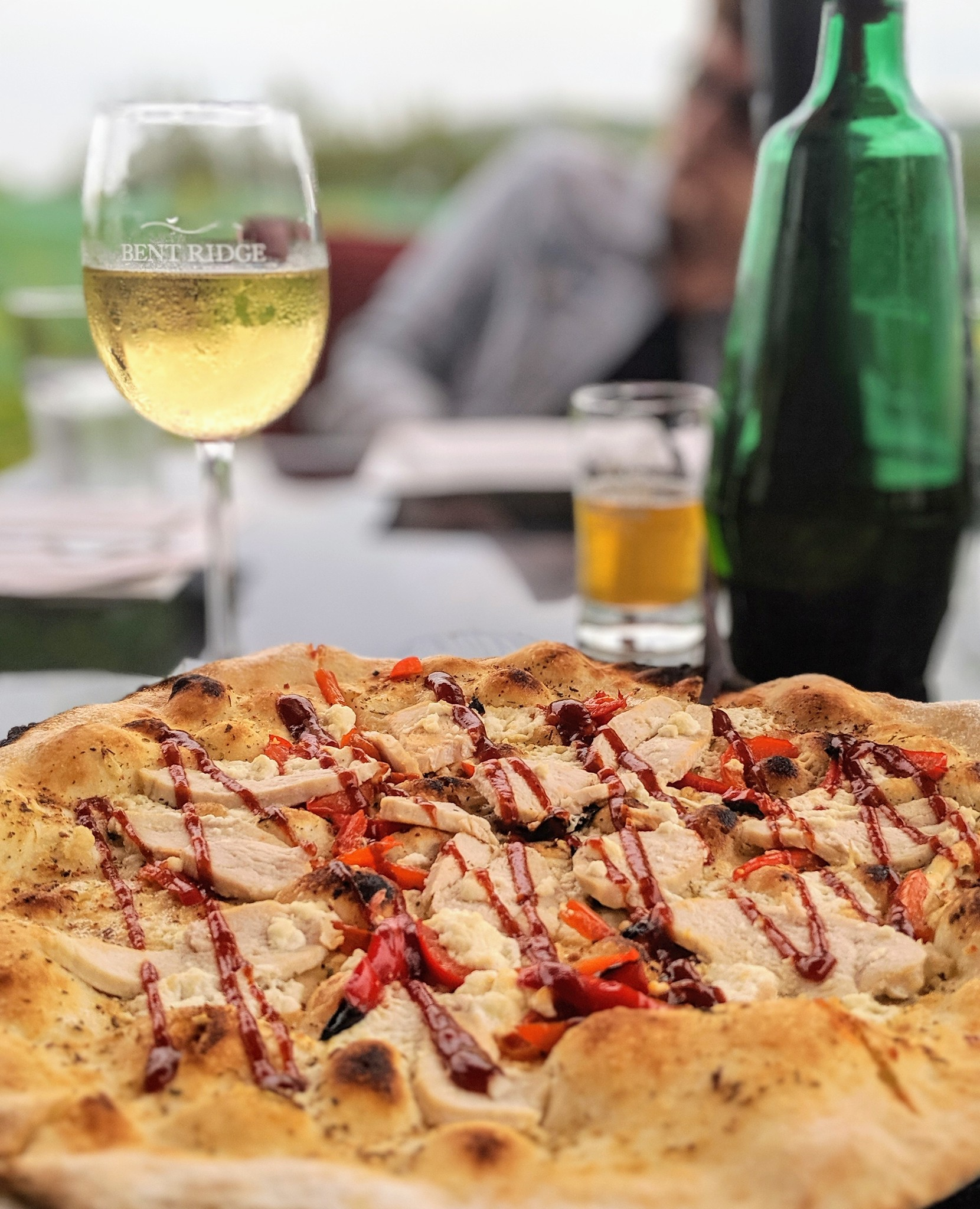 Barbecue chicken pizza and white wine at Bent Ridge Winery in Nova Scotia
