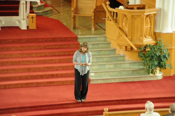 Francis singing in the church on the Cabot trail