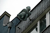 In Cologne, a bronze figure on the side of an old building expresses displeasure with polticians at the time by mooning them as they walk under