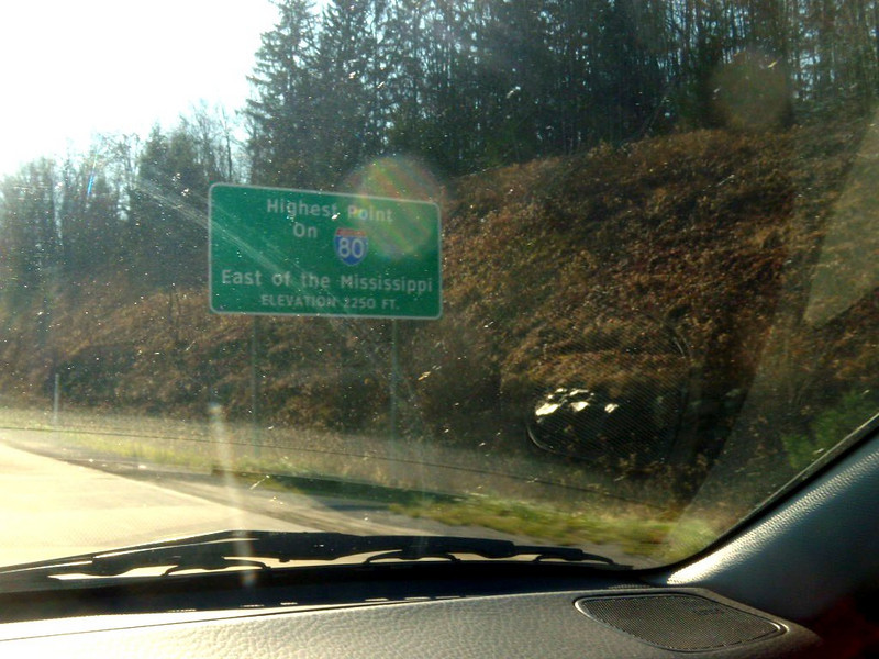 Some dead bugs now on my windshield, but the sign says:HIGHEST POINT ON I-80, EAST OF MISSISSIPPI. ELEVATION 2250 FEET near Clearfield Penna..