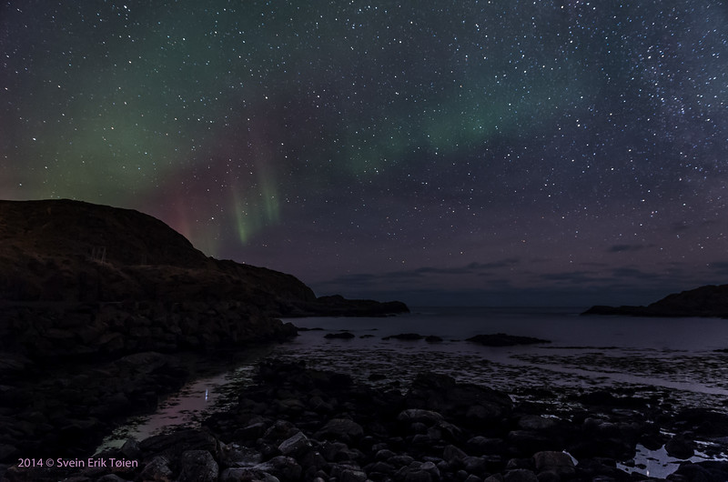 Starry night with some aurora over the old boat hauls, Nyksund
