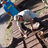 Peter's helping make the adobe bricks along the way.