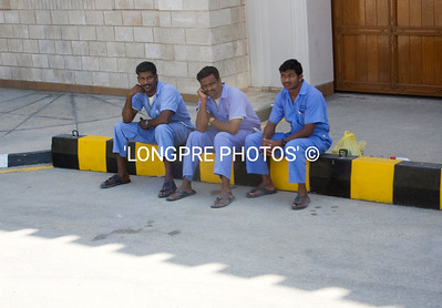 Palace workers taking a rest. SALALAH