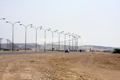 Road between port of SALALAH  and town of SALALAH.