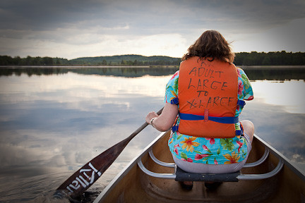 EVENING CANOE TRIP ON THE MIRROR-LIKE WATER OF LAKE OF TWO RIVERS