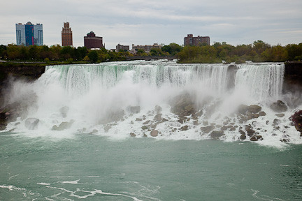 AMERICAN FALLS WITH THE CITY OF NIAGARA FALLS, NEW YORK IN THE BACKGROUND