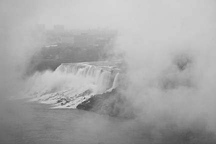 AMERICAN FALLS AS SEEN THROUGH A HOLE OF A MOVING CLOUD