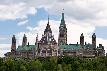 PARLIAMENT HILL'S COPPER ROOFS AS SEEN FROM THE OTTAWA RIVER