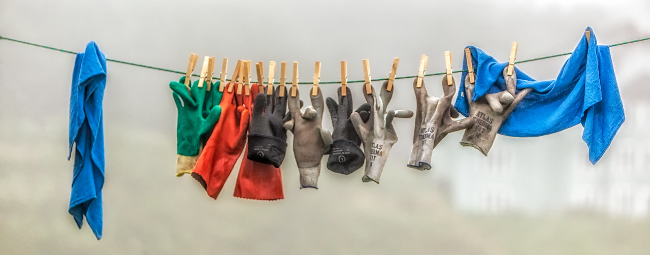 "GLOVES ""HUNG"" TO DRY ON A FISHING BOAT"