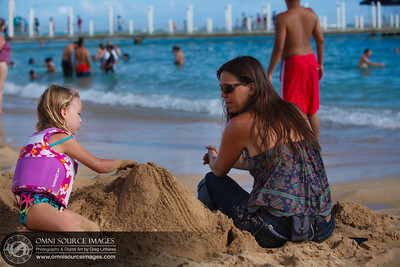 Maisie and mommy building a Diamond Head replica in the sand.