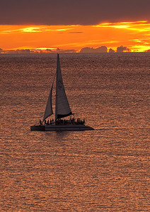 Sailing off Oahu into the sunset.