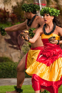 Holding the fire in the coconuts while performing a traditional Hawaiian dance.