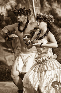 Hawaiian performers doing a ceremonial dance.