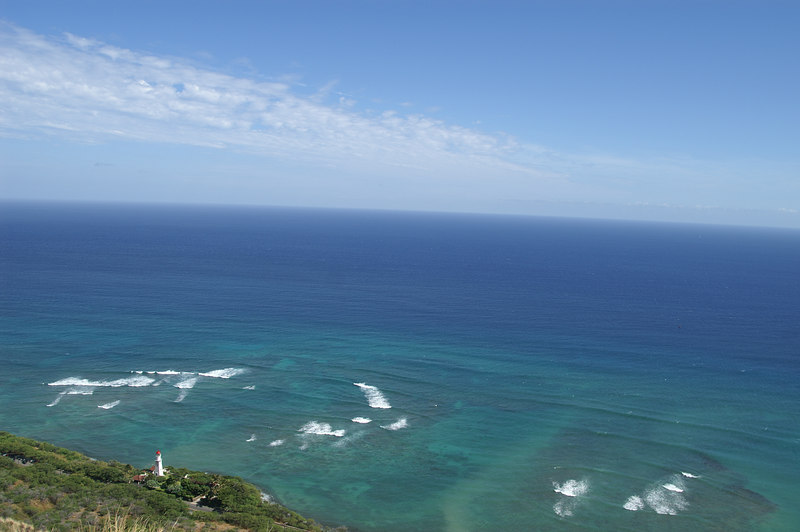 Lighthouse and ocean from the top of Diamond Head crater