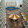 Hu.ndreds of balcony cabins face the Boardwalk and the sea facing aft n Oasis. These are very popular cabins charging a premium onboard for its varied views of shipboard activity
