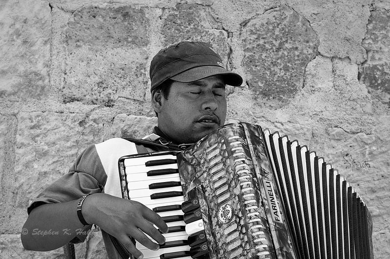 Blind accordian player. Oaxaca de Juarez, Mexico