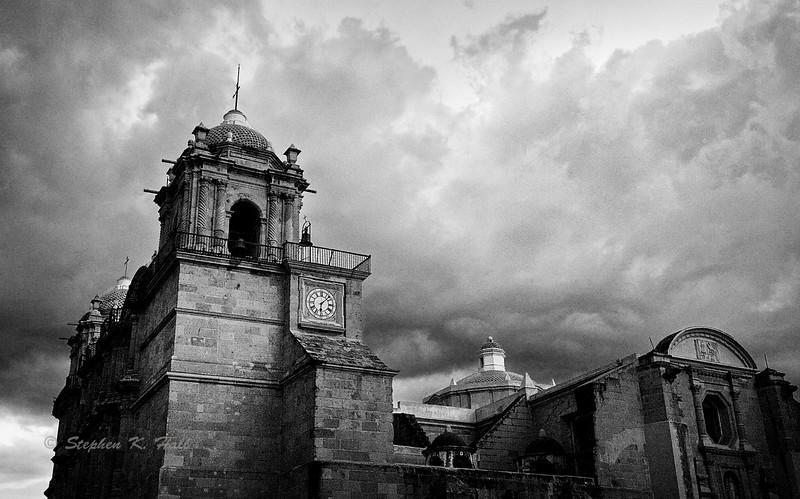 Storm clouds over cathedral, Zocalo. Oaxaca de Juarez, Oaxaca, Mexico.