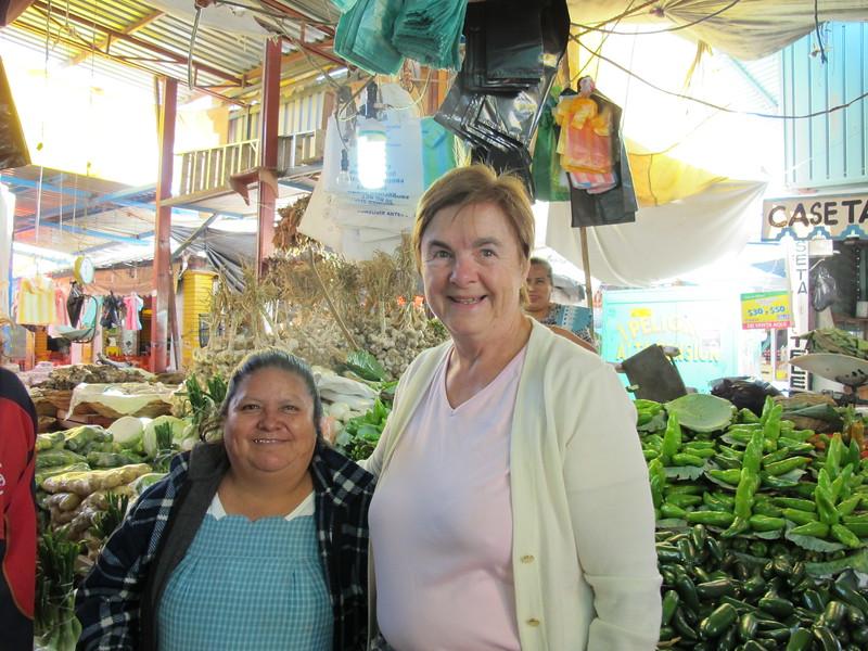 Susan with a vegetable seller in the Mercado de Abastos, Oaxaca's largest market.