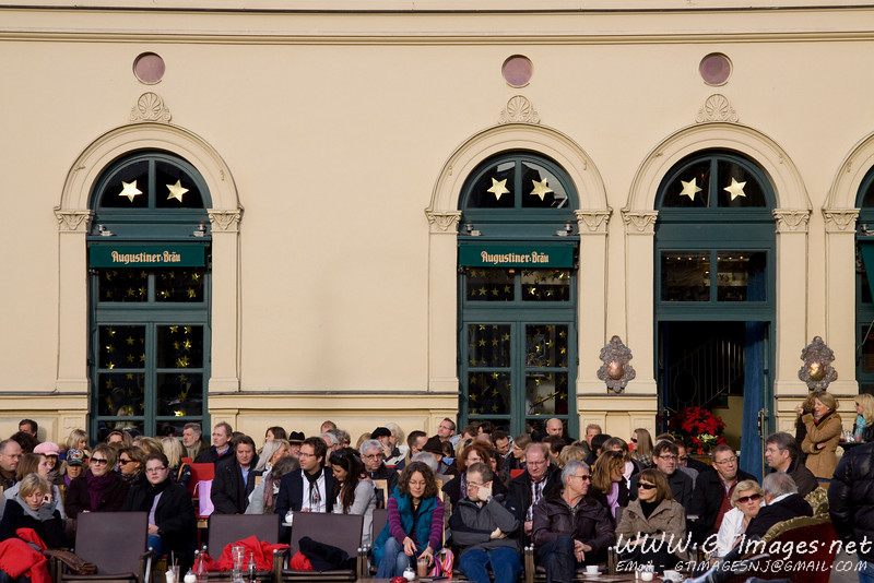 München, Germany - Bierhalle. Everyone is facing the same direction to catch the last rays of sun before the winter sets in.
