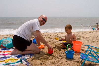 Sand castle creation continues at a feverish pace in order to keep ahead of the one person wrecking crew that is K.C.