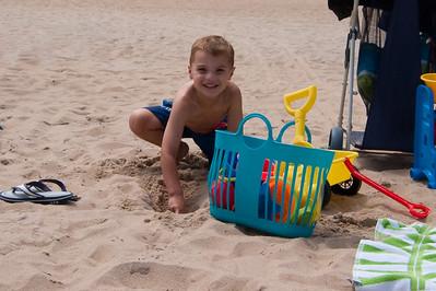 K.C. enjoys digging in the sand.