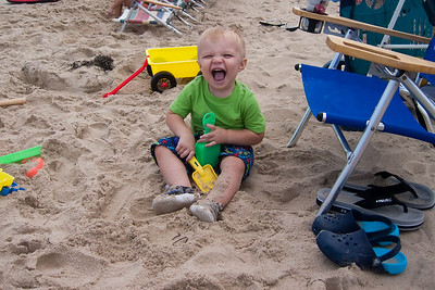 Ethan enjoys digging in the sand.