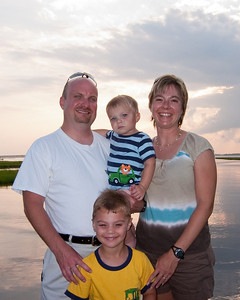Family portrait before sunset on the bay.