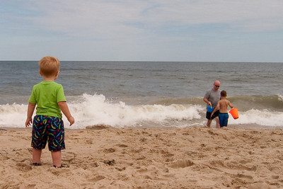 Ethan watches two Kurts in the surf.
