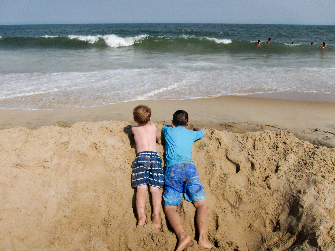 K.C. and Ethan take a break to enjoy watching the waves.