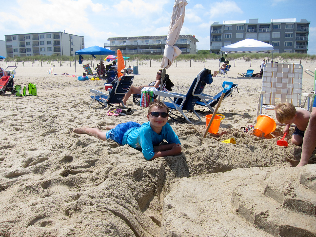 K.C. takes a break from building sand castles.
