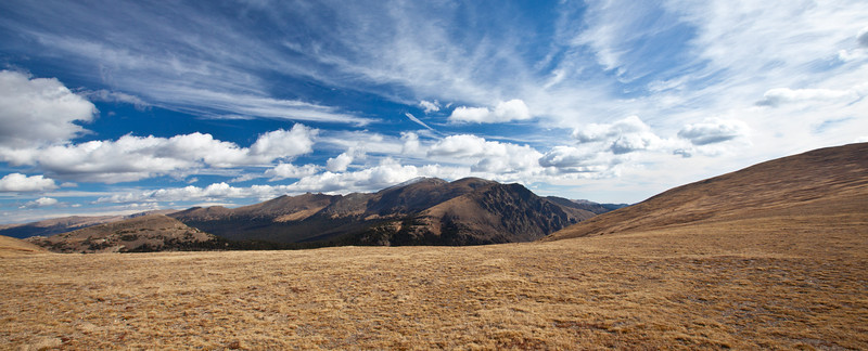 View from Trail Ridge Road over a meadow and peaks. Rocky Mountain National Park, Colorado.