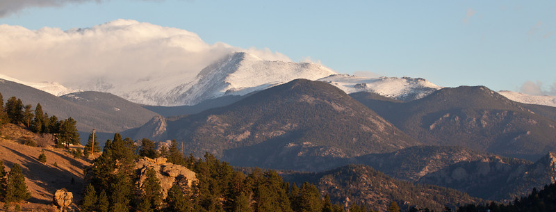 The first snow capped peaks of fall arrive in the Rocky Mountains. Rocky Mountain National Park, Colorado