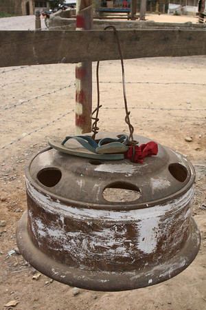 School bell made from tire rim. Love the ingenuity. Village near Luang Prabang Province, Lao PDR.
