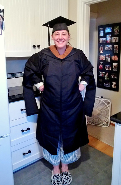 Kari tries on her cap and gown...hopefully those shoes are not part of the outfit.