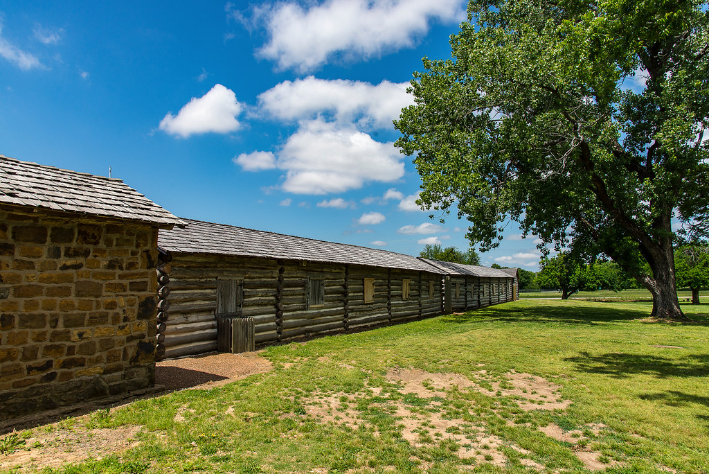 Fort Gibson is a National Historic Landmark in Eastern Oklahoma. Fort Gibson (Indian Territory) was constructed in 1824 to keep peace between warring Native American tribes in the area and was a base of operations for many expeditions. The fort was first abandoned in 1857, but reactivated during the Civil War and used as a base for post-war Reconstruction activities.<br /> <br /> During its history, Fort Gibson became a vital point in U.S. relations with the so-called Five Civilized Tribes as they were forced west on the Trail of Tears and became a final stop on the Trial of Tears for thousands of Cherokee, Creek and Seminole families.<br /> <br /> Over its 70-year history it was rebuilt several times and renamed twice. The Union Army of the Frontier occupied the fort in late 1862, renaming it as Fort Blunt after General James G. Blunt of Kansas. After the U.S. Civil War ended, the post was renamed back to Fort Gibson. In 1890, the U.S. Army declared the post obsolete and abandoned it.<br /> <br /> Surviving or reconstructed structures include the stockade, the barracks, the magazine, hospital and bake-house. A museum helps orient visitors to the different parts of the large historic site. In addition, a small section of the earthworks built during the Civil War when the post was called Fort Blunt still survive.<br /> <br /> Operated by the Oklahoma Historical Society, the site also hosts a number of special living history events and programs throughout the year.