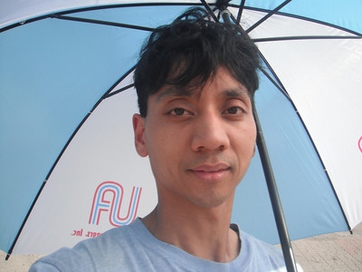 It's hot (over 90's), so I had to use this umbrella that was given free while walking around this autcion auto-truck dealership with my Cuz!
