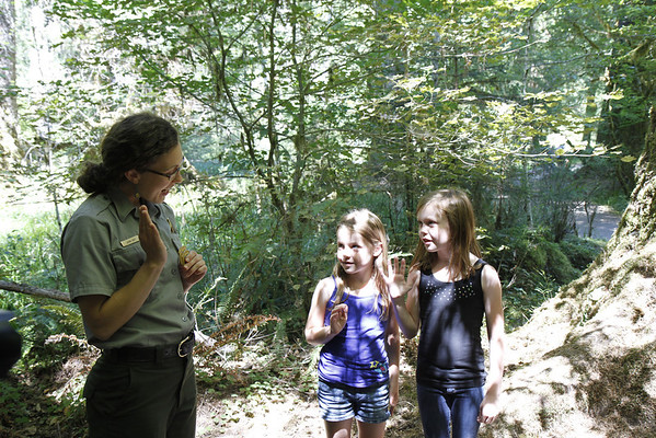 Swearing in of Junior Ranger Eva and Junior Ranger Fiona at the Hoh River Rain Forest.  With Ranger Laura.