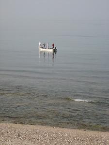 Fishermen checking their nets.